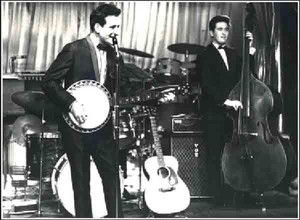 Lonnie Donegan on stage, early AC50 behind him